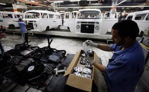 Volkswagen campers: VW badges arranged on the assembly line