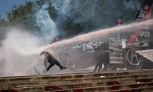 Protester knocked back by water canon