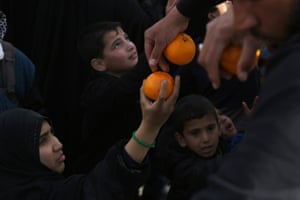 Oranges are distributed to Iraqi Shiite Muslim pilgrims as they walk along the main highway from Najaf to the central shrine city of Karbala to take part in the Arbaeen religious festival which marks the 40th day after Ashura commemorating the seventh century killing of Prophet Mohammed's grandson, Imam Hussein.