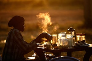 Goran Tomasevic: A woman prepares tea at an outdoor shop in the town of Abyei in October