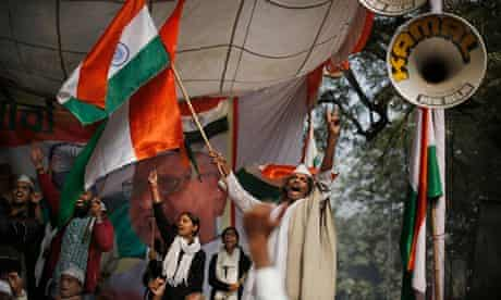 Indians celebrate the passing of the contentious lokpal bill