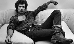 Guitarist Keith Richards of the Rolling Stones, lounges in his New York City office during a 1980 portrait session.