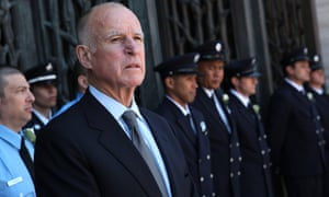 California governor Jerry Brown looks on during funeral services for two San Francisco firefighters.