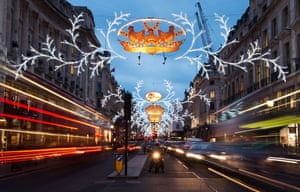 Traffic passes under the Christmas lights in Regent Street in central London.