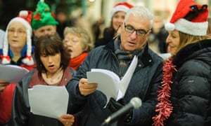 The parents of Amy Winehouse, Janis and Mitch, join singers from the Amy Winehouse Foundation as they perform Christmas carols in St Pancras Station, in central London.