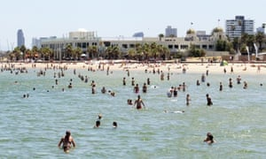 Crowds cool off at St Kilda beach during heatwave conditions in Melbourne