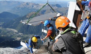 Workers putting together the platform for the skywalk. Construction jobs don't come more terrifying than this.