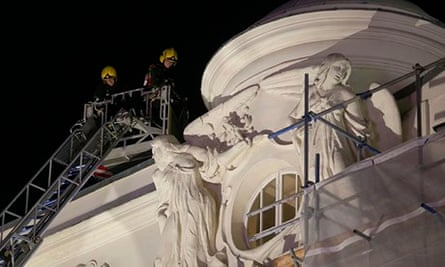 Apollo: firefighters inspect the roof