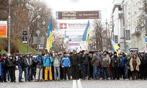 Anti-government protesters near barricades which blocked a street in Kiev