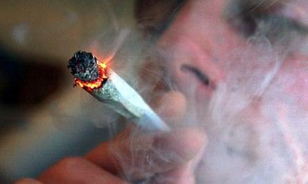 A man smoking a cannabis cigarette
