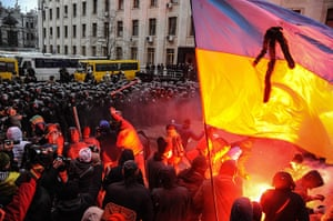 Ukraine update: Protesters light flares as they continue to battle with riot police
