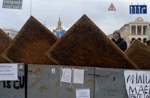 Ukraine update: Protester stands behind barricade on Independence Square
