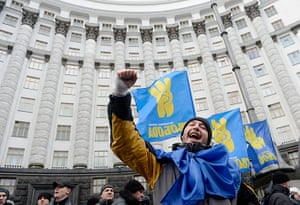 Ukraine update: A protester shouts slogans while blocking the Cabinet of Ministers building
