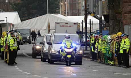 Rescue workers form a guard of honour for ambulances removing bodies from the Clutha bar 2/12/13