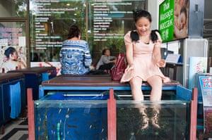 Chinese tourists: Yu Meng Na gets afish pedicure at Pattaya Park Tower