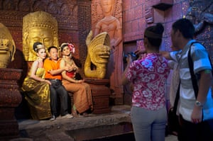 Chinese tourists: A Chinese tourist poses with two ladyboys