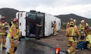 Tour bus crashes off slick Los Angeles freeway and injures