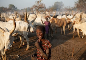 Top10: A boy from Dinka tribe smiles in a Dinka cattle herders camp near Rumbek