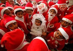 Top10: Children dressed in Santa Claus in Indi