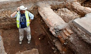 Archaeologist Mathew Morris stands in the Richard III trench