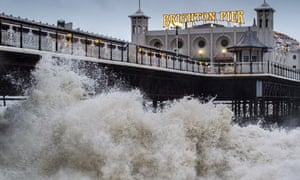 Angry waves lash against Brighton Pier on December 23, 2013 in Brighton, England.  Britain is being hammered by powerful storms which has caused disruption in air, road and rail transport.