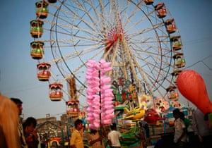 Top ten: Mumbai, India: A man waits for customers to sell candy floss at the Mahim f