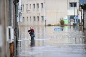 Top ten: Britanny , France: A man walks in a flooded street in Morlaix