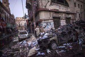 Top ten: Mansura, Egypt: Egyptian men inspect destruction following a powerful car b