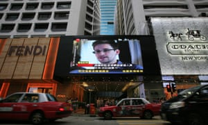 "FOR USE AS DESIRED, YEAR END PHOTOS - FILE - A TV screen shows a news report of Edward Snowden, a former CIA employee who leaked top-secret documents about sweeping U.S. surveillance programs, at a shopping mall in Hong Kong Sunday, June 23, 2013. The former National Security Agency contractor wanted by the United States for revealing two highly classified surveillance programs has been allowed to leave for a ""third country"" because a U.S. extradition request did not fully comply with Hong Kong law, the territory's government said. (AP Photo/Vincent Yu, File)"