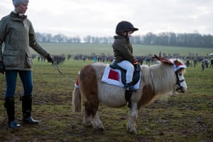 Boxing day hunt: Rebecca Mills with her daughter Ada on 'Bryan' the miniature Shetland pony,