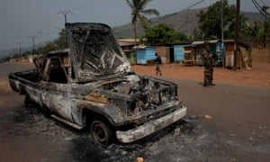 French soldiers stand guard around a burnt-out truck in the Gobongo district of Bangui on Thursday.