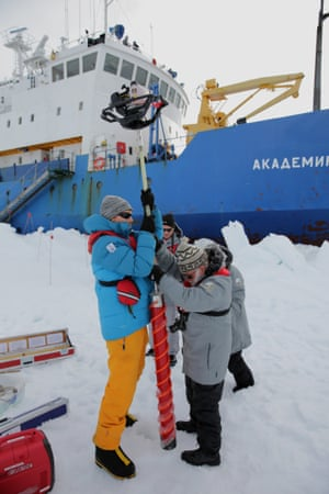 Members of the expedition take ice samples while awaiting rescue