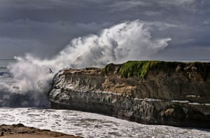 20 Photos: A surfer leaps into the sea from Lighthouse Point, Santa Cruz