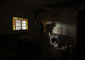 20 Photos: A Free Syrian Army fighter carries his weapon in a house in Deir e-Zor
