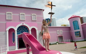 20 Photos: A Femen activist in front of the Barbie Dreamhouse in Berlin