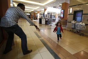 20 Photos: A child runs to safety at the Westgate mall in Nairobi