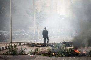 20 Photos: An Egyptian man walks through smoke during clashes in Cairo