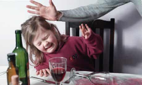 A child is smacked for knocking over a drink (image posed by model)