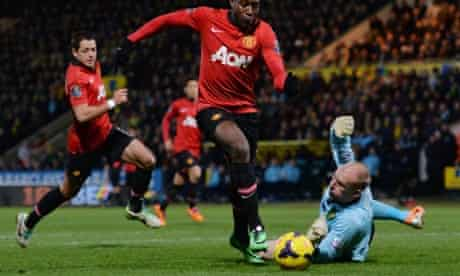 Manchester United's Danny Welbeck scores the opening goal past Norwich City's goalkeeper John Ruddy
