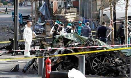 Lebanese police inspect scene of the car bomb that killed ex-minister Mohamad Chatah