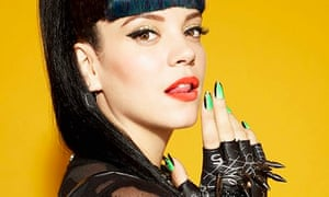 Lily Allen poses with green nail varnish and red lipstick