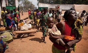 Families fleeing conflict arrive at a displaced persons camp in Central African Republic.