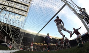 Arsenal clear the ball off their line.