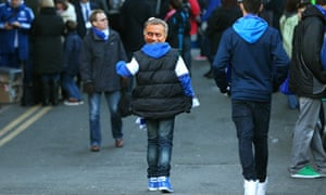 A young fan wearing a Mourinho mask arrives.