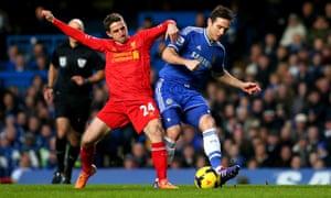 Frank Lampard of Chelsea is tackled by Joe Allen.