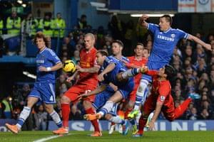 football-: The ball heads goalward from a header by