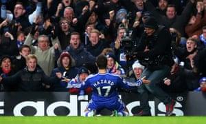 Eden Hazard heads off to celebrate.