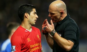 Hot chat, starring Howard Webb and Luis Suárez.