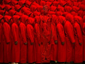 Liu stands in front of people dressed entirely in red in his studio for a piece he calls 'Red' by Liu Bolin in Beijing, China. He chose red as he feels it has deep roots in China's history.