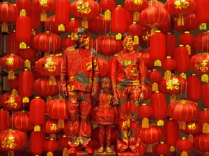 'Family Photo' a Chinese family are camouflaged by Liu Bolin in Beijing, China.